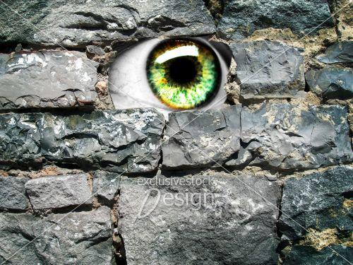 Oeil plusieurs couleurs sortant mur pierre