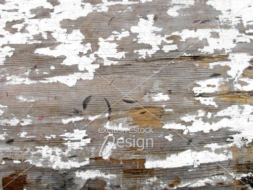Taches peinture blanche écaillée bois troué
